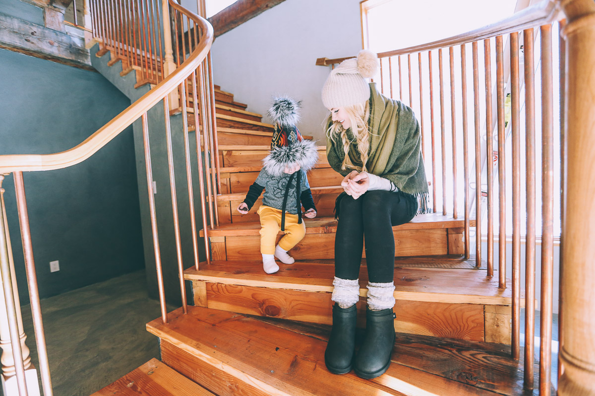Barefoot Blonde Amber and Atticus on the stairs wearing UGG Australia