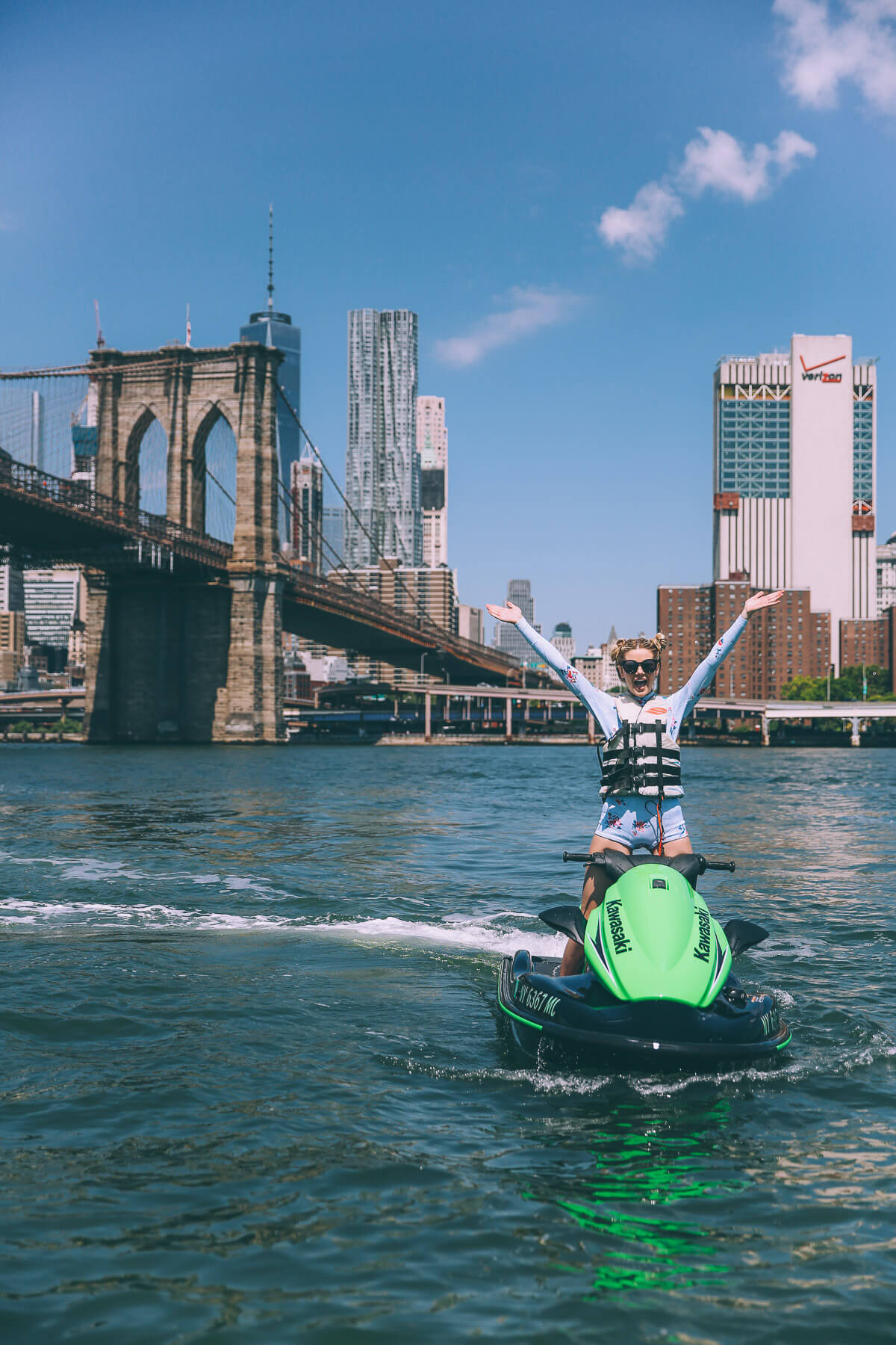 Barefoot Blonde Amber Fillerup Jetskiing underneath the Brooklyn Bridge
