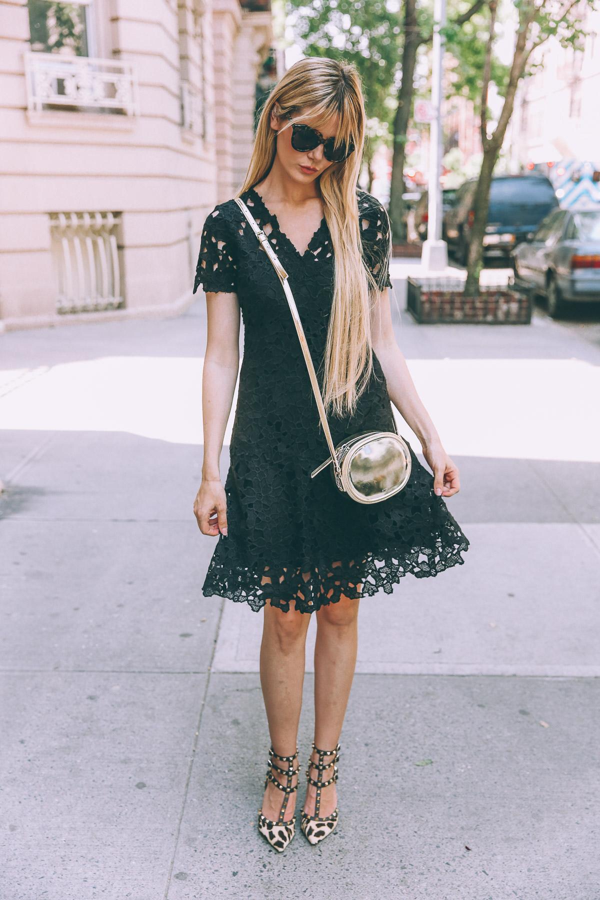 Barefoot Blonde Amber Fillerup wearing Elie Tahari
