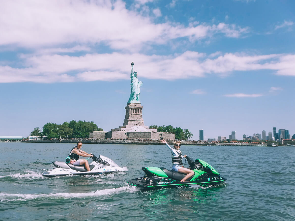 Barefoot Blonde Amber Fillerup and David Clark Jetskiing on the Hudson by Statue of Liberty
