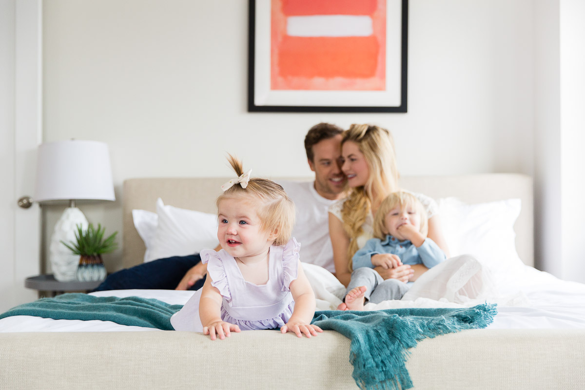 Barefoot Blonde Amber and the family on the bed