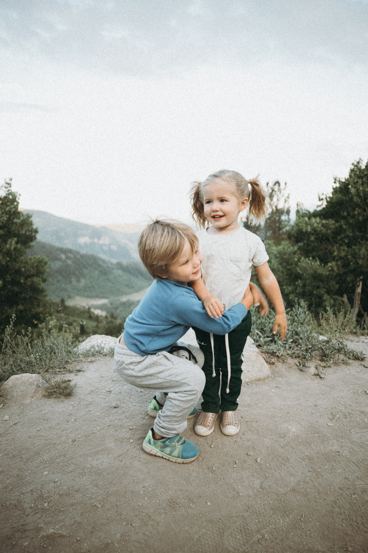 Atticus picking up Rosie during our summer camping trip. Barefoot Blonde.