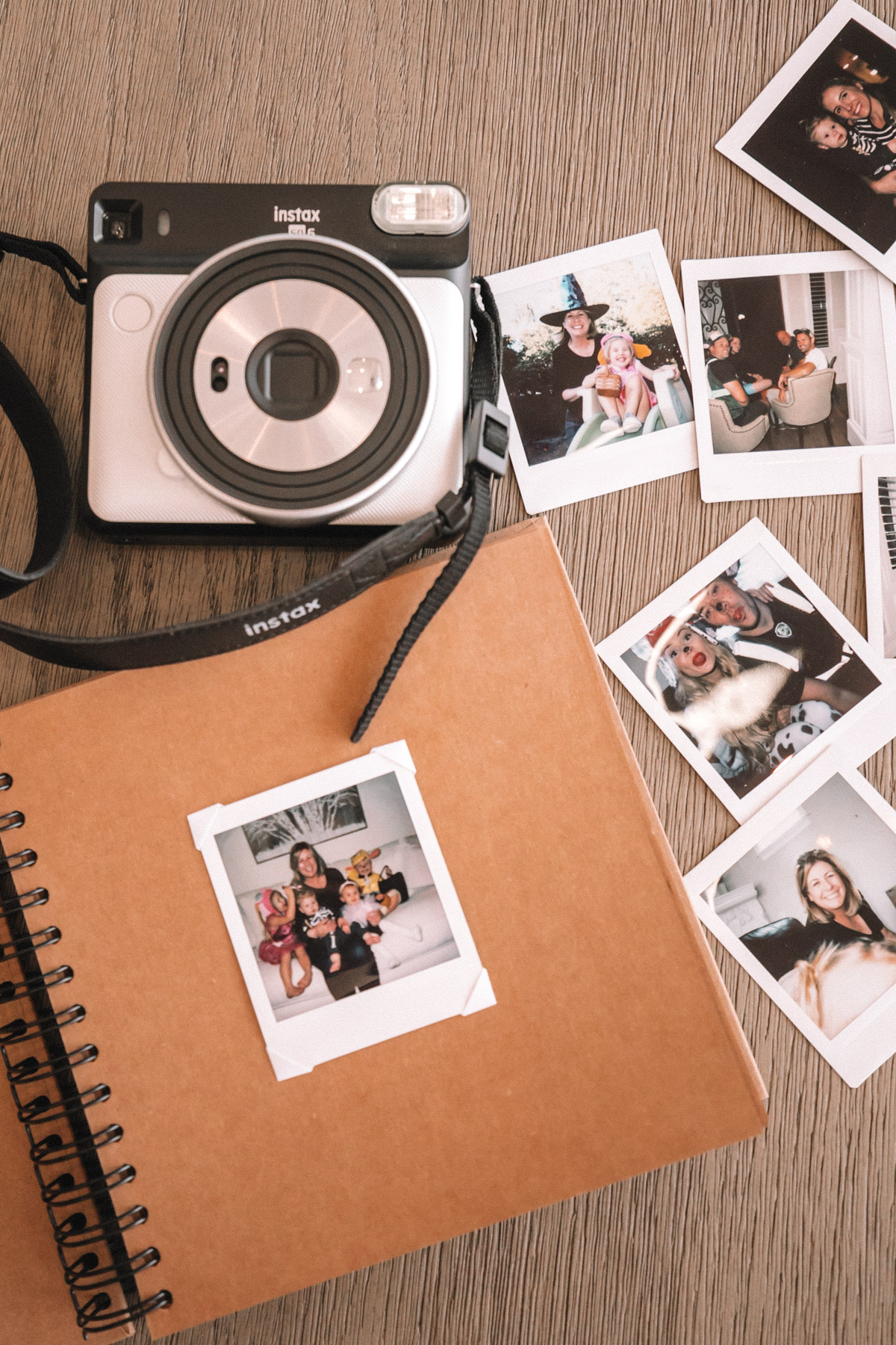Amber, Rosie and Atticus scrapbooking with their Fujifilm prints. A Meaningful Gift for Grandma and Grandpa | Barefoot Blonde | Amber Fillerup Clark
