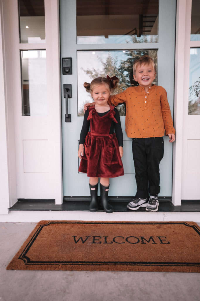 Atticus and Rosie in front of their home. A Meaningful Gift for Grandma and Grandpa | Barefoot Blonde | Amber Fillerup Clark
