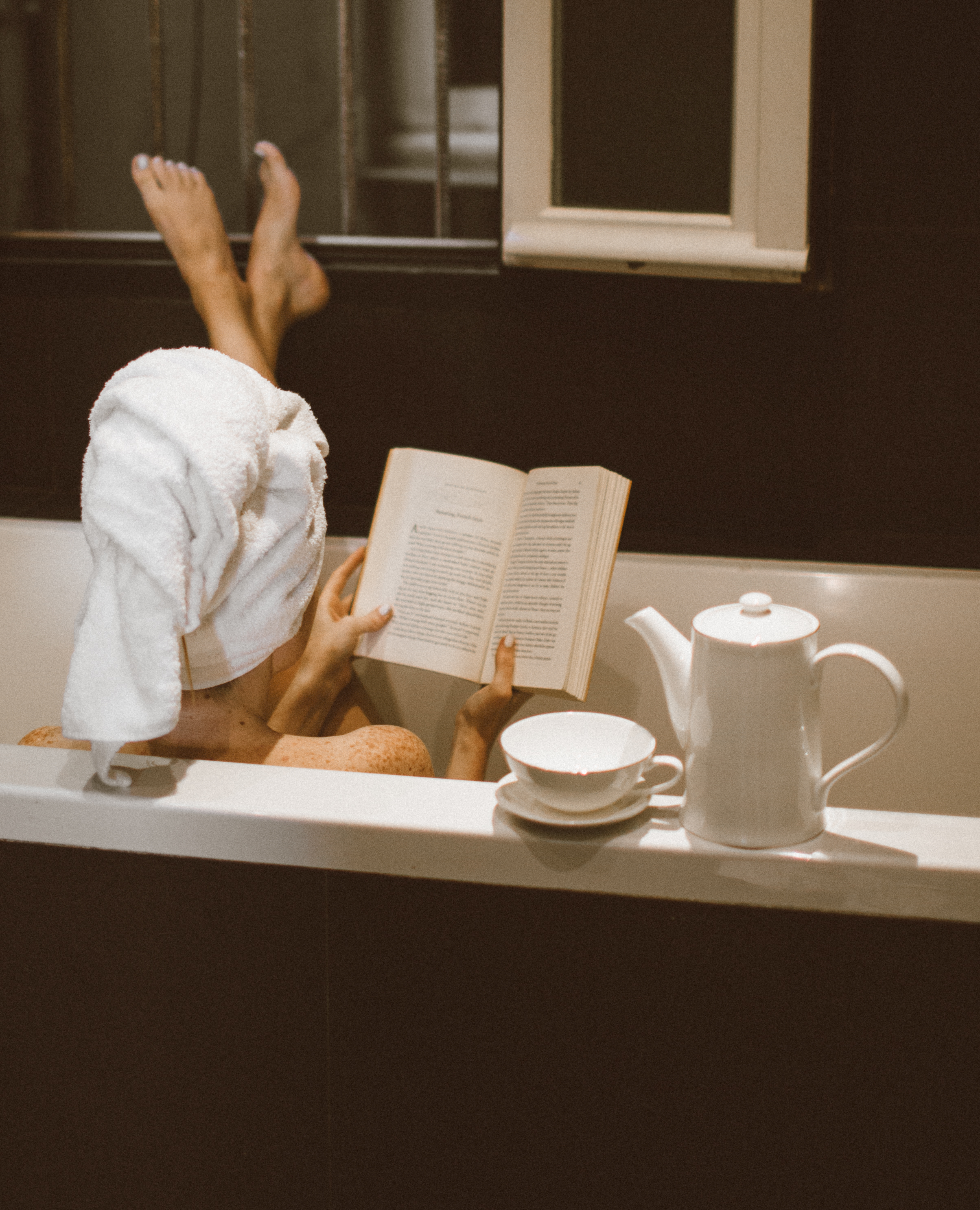 Woman reading in the bathtub for the Holiday Gift Guide: Books for Every Woman in Your Life. Barefoot Blonde | Amber Fillerup Clark