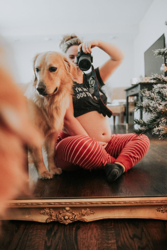 Photographer and Barefoot Blonde Contributor Kylie Thompson with her golden retriever documenting her pregnancy with her camera. Barefoot Blonde by Amber Fillerup Clark