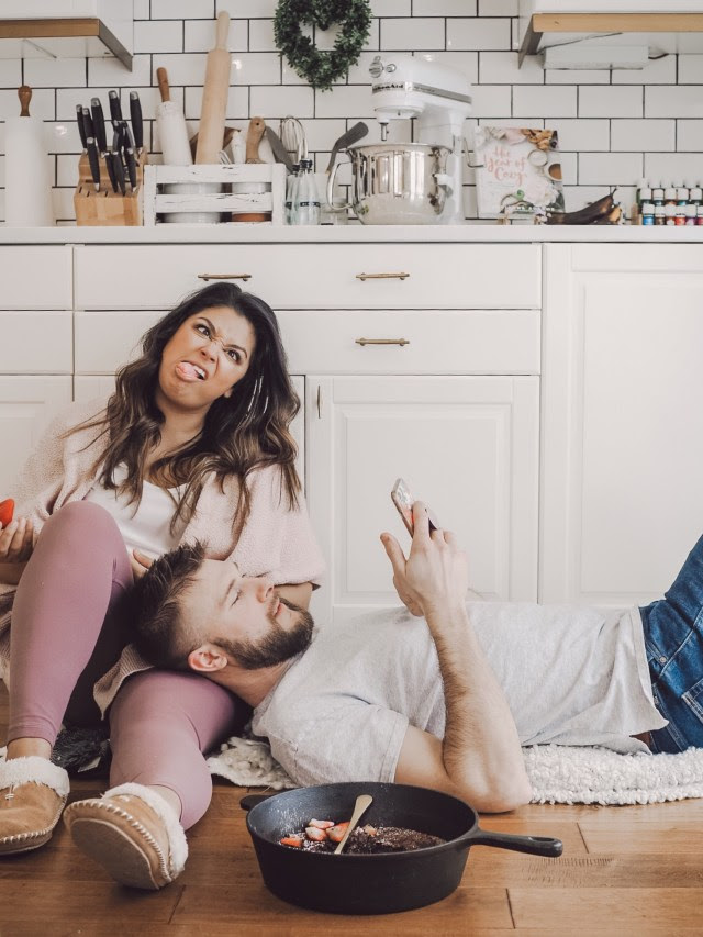 BFB Contributor Claudia Redel with her husband in their kitchen. 16 Valentine's Day Date Night Questions | Barefoot Blonde