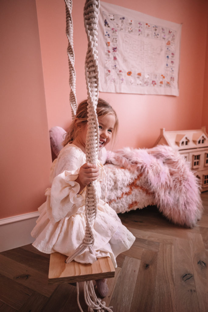 Sunday Swinging in Rosie's Room. Rosie swinging in her bedroom. Barefoot Blonde | Amber Fillerup Clark
