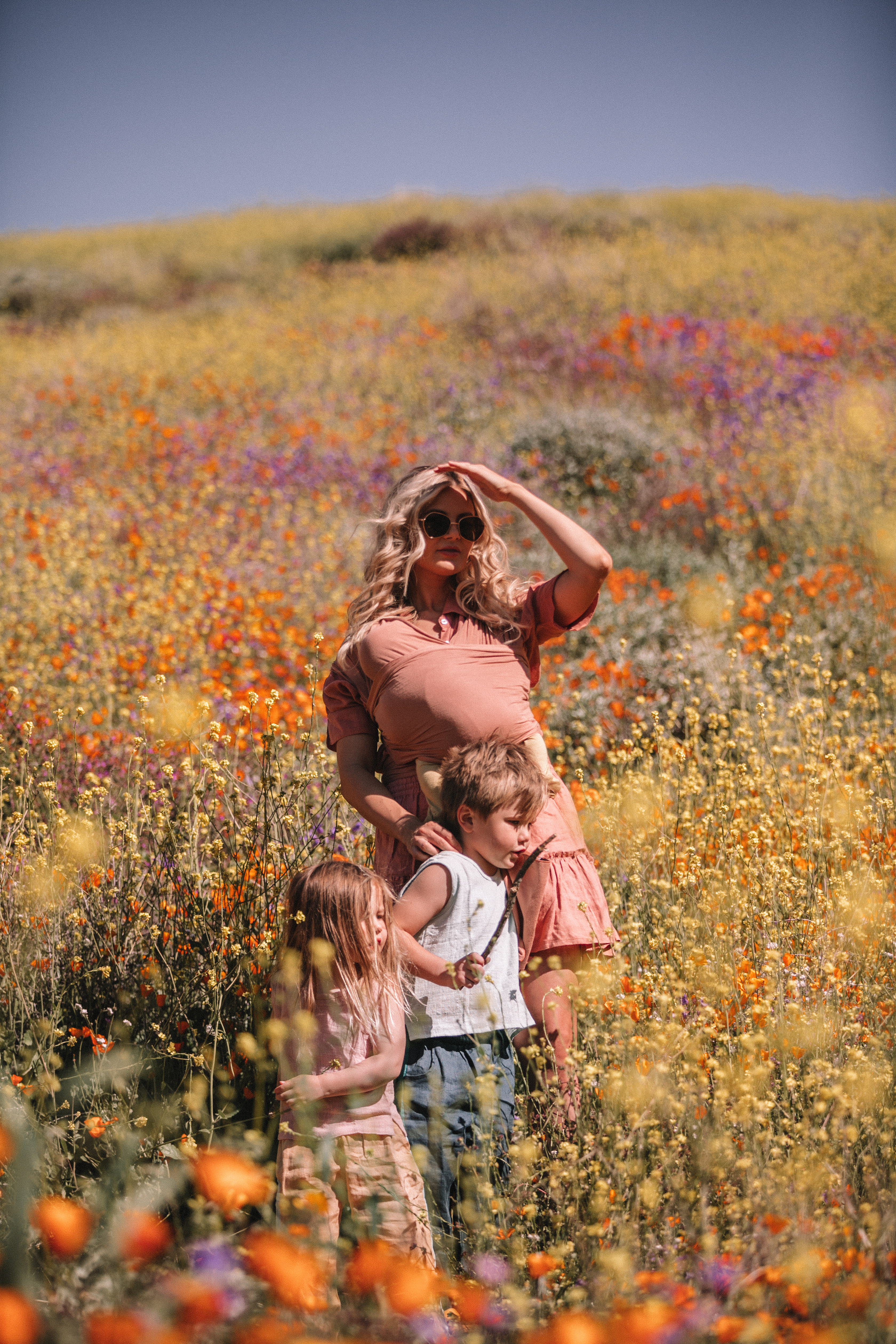 Amber, Atticus, Frankie and Rosie visiting the Super Bloom in Lake Elsinore, California. Barefoot Blonde | Amber Fillerup Clark