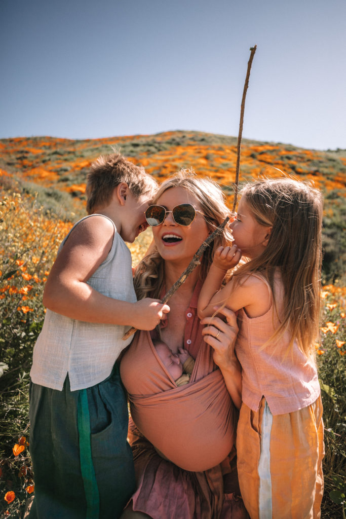 Amber, Atticus, Frankie and Rosie visiting the Super Bloom in Lake Elsinore, California. Barefoot Blonde   Amber Fillerup Clark