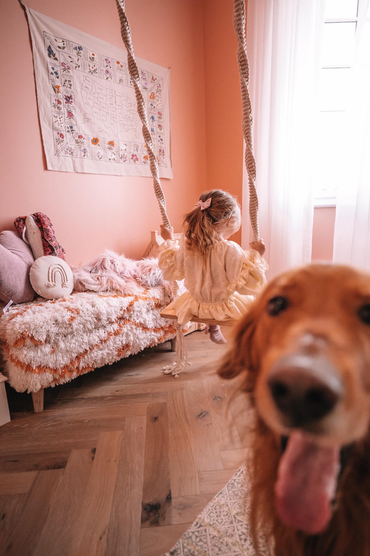 Sunday Swinging in Rosie's Room. Rosie swinging in her bedroom with Chauncey. Barefoot Blonde | Amber Fillerup Clark