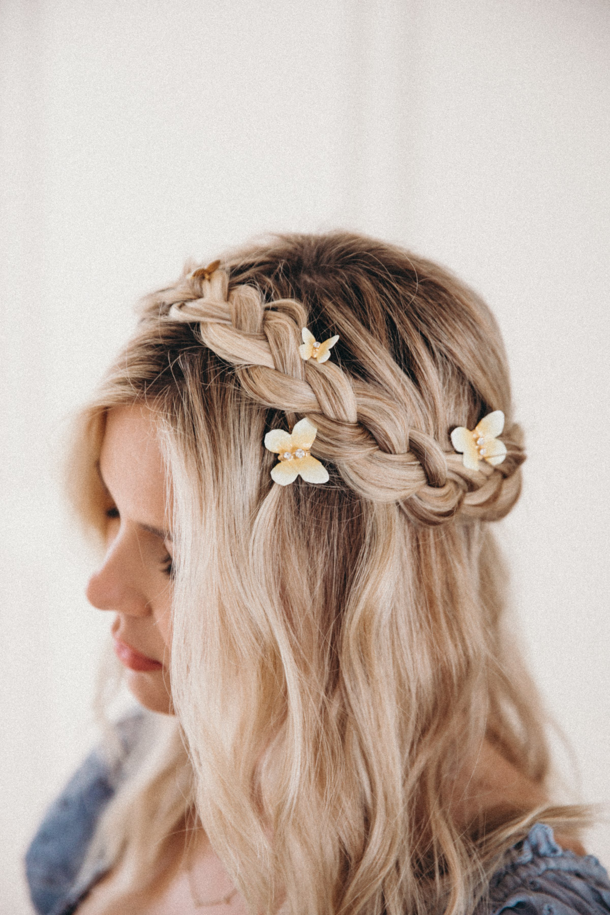 Amber Fillerup Clark wearing BFB Hair with braids and butterfly clips in her hair. Barefoot Blonde | Amber Fillerup Clark