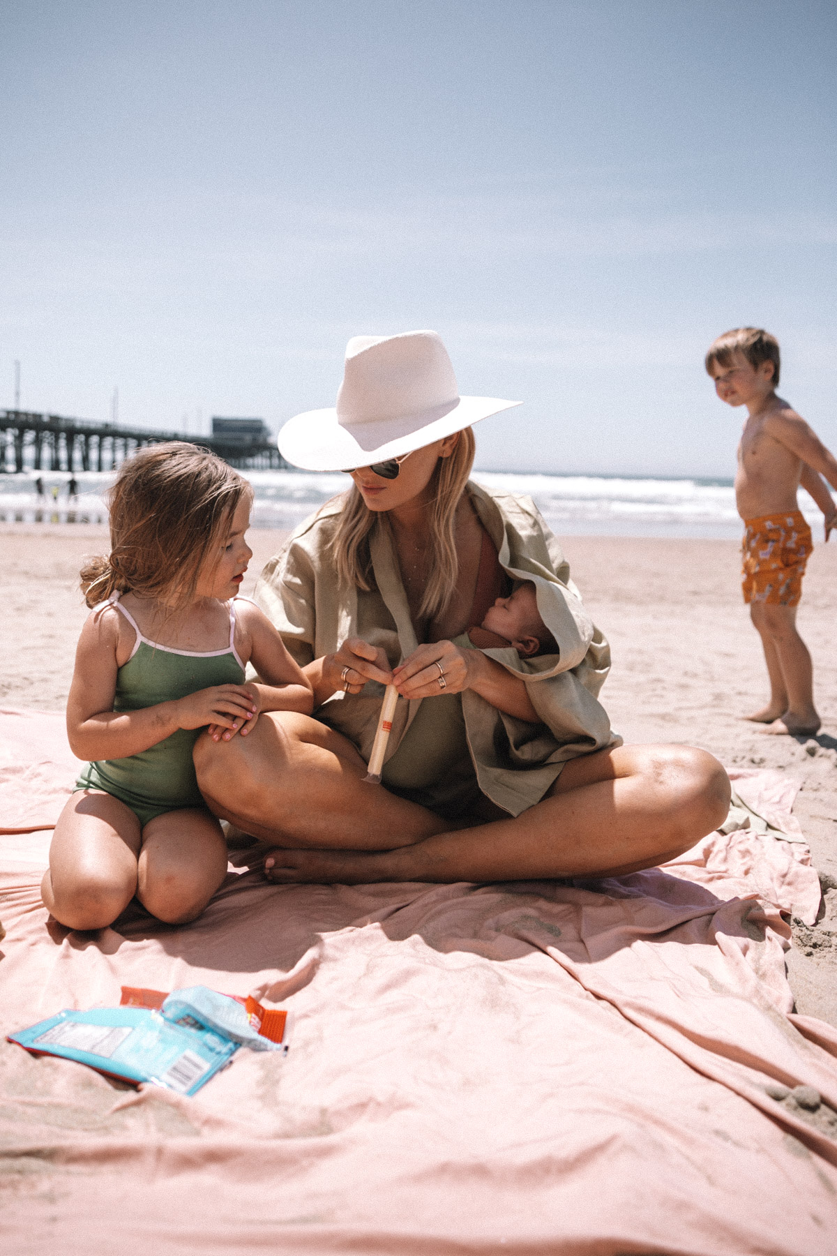 Rosie, Atticus and Amber on the beach in California. Barefoot Blonde | Amber Fillerup Clark